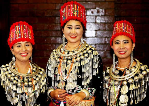 Three Asian women in traditional costumes