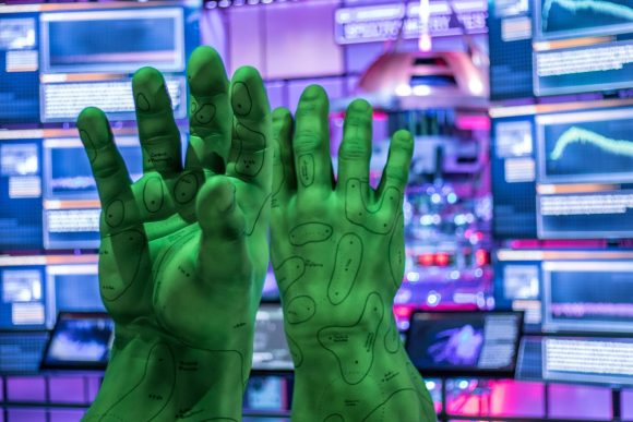 A sculpture of big green hands