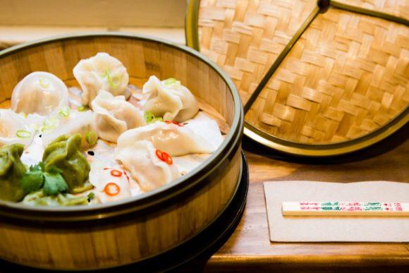 A bamboo basket full of dumplings
