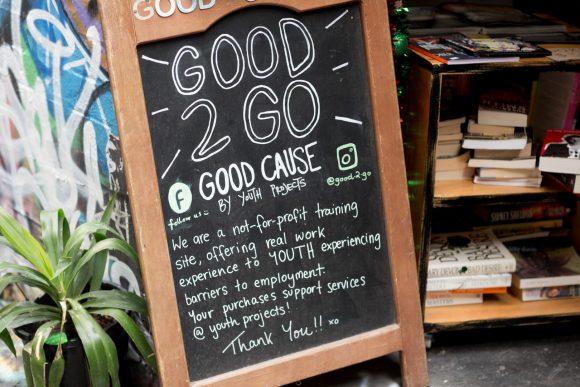 A writing on a blackboard outside a cafe