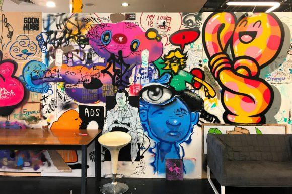 A street art mural inside a studio