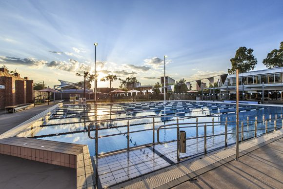 A big open air swimming pool at sunrise