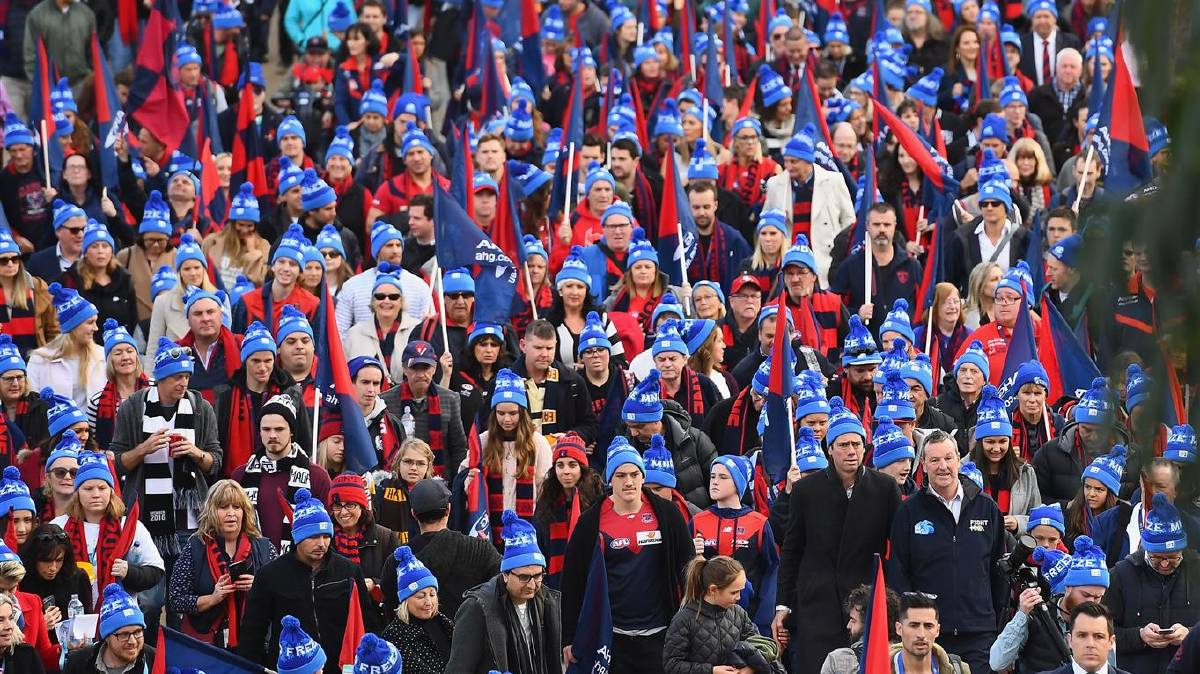 Crowd of Melbourne Demons supporters wearing beanies during previous Big Freeze at the G