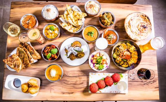 An array of Indian food on a table