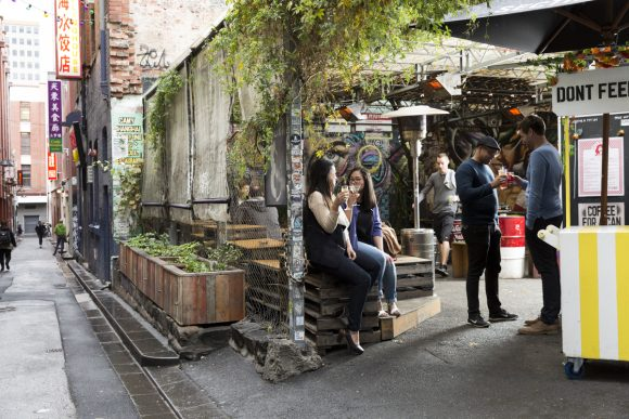 People drinking in an outside bar in a laneway