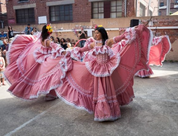 Women dancing in long costumes