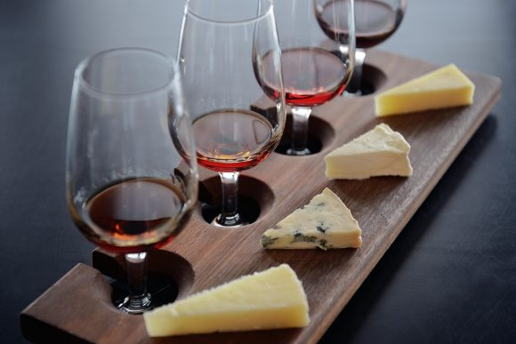 A platter with 4 cheese and 4 glasses of wine