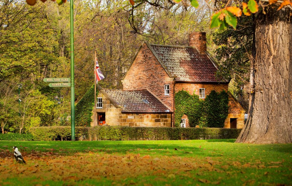 An old house in a leafy park in autumn