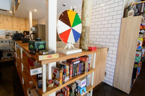 Shelves full of board games at a cafe