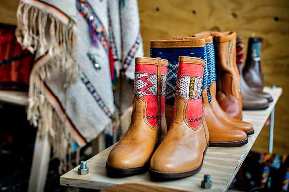 Boots on display in a market stall