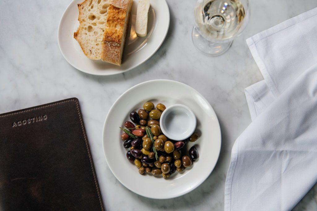 Marinated olives and wine
