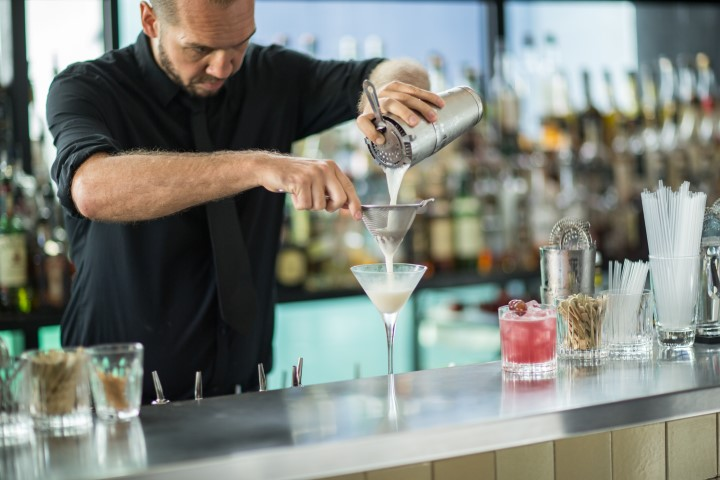 A barman making a cocktail
