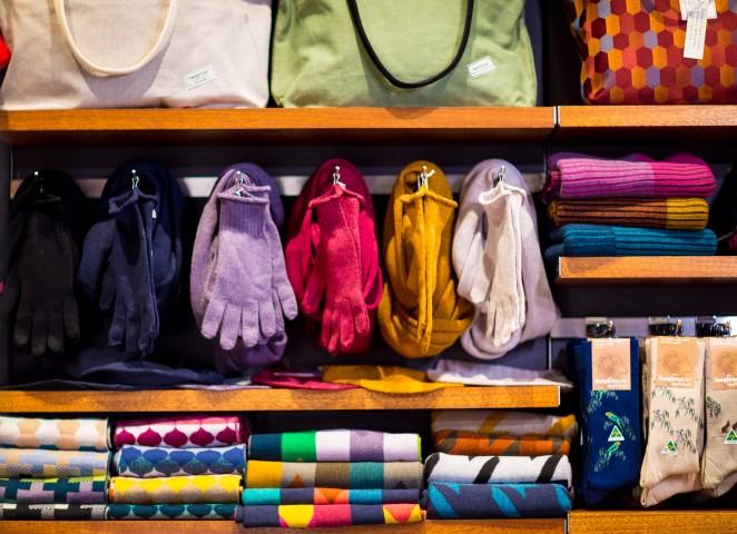 Shelves of winter woollens including scarves, socks and gloves