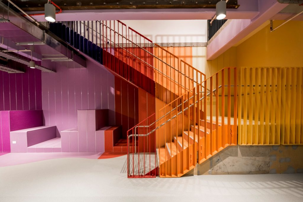 An artistic shot of a multi coloured staircase