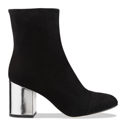 A high heeled ankle boot with a metallic heel