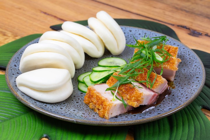 A plate of pork belly and bao buns