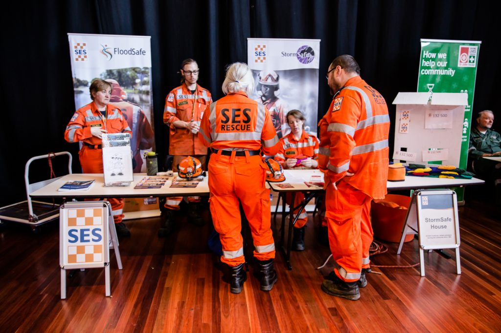 A group of SES workers at an information stall