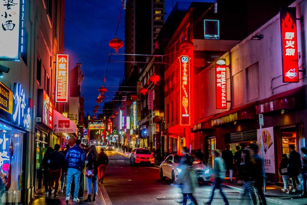 A bustling Chinatown district at night