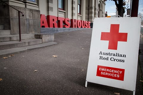 An Australian Red Cross sign in front of Arts House North Melbourne