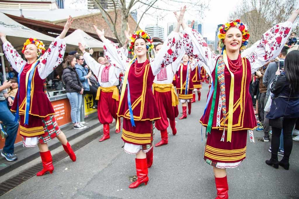 A group of women in traditional European outfits in a parade