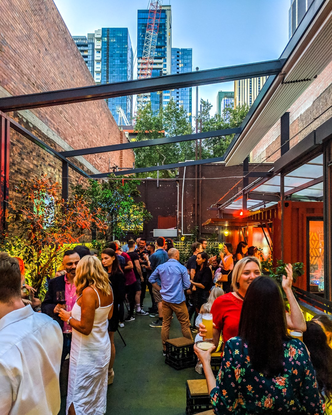 A rooftop bar with astroturf and an open roof