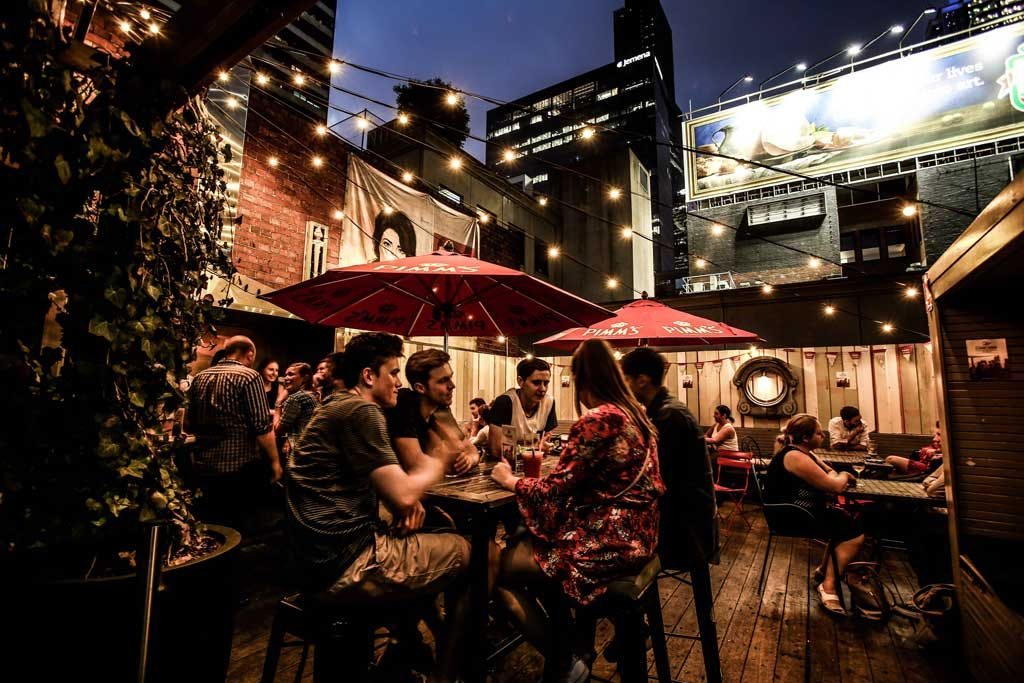 A rooftop bar with fairy lights