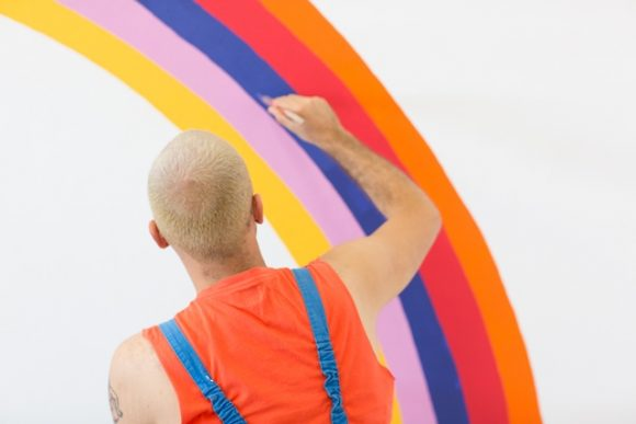 an artist painting a colourful painting
