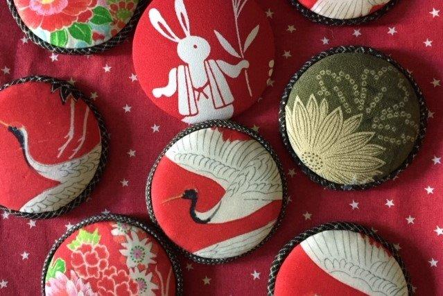 Festive brooches covered with Japanese material