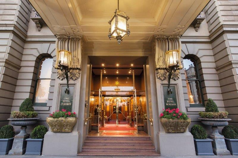 Grand entrance way to the Windsor hotel, with steps and brass trimmed doors and railings