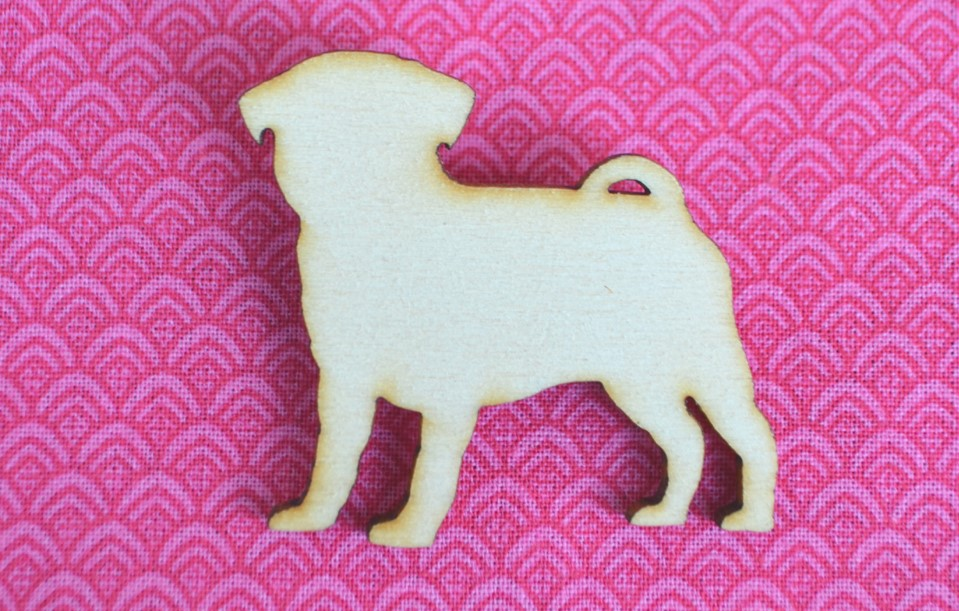 Pug brooch made from eco plywood on pink background