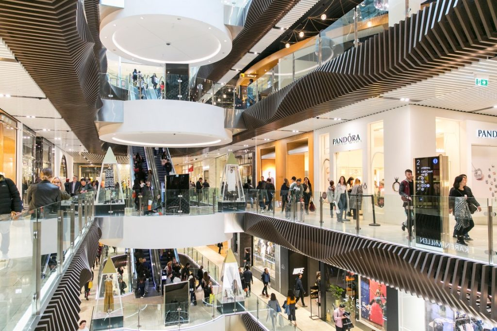 A view of a busy shopping centre over three levels