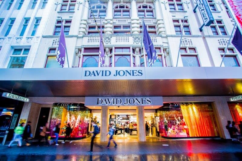 The outside view of David Jones store in Bourke Street, lit up at night