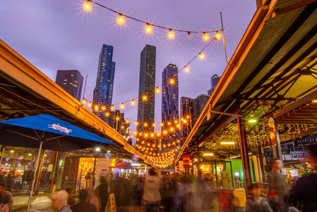 Hanging lights above a laneway at an outdoor market
