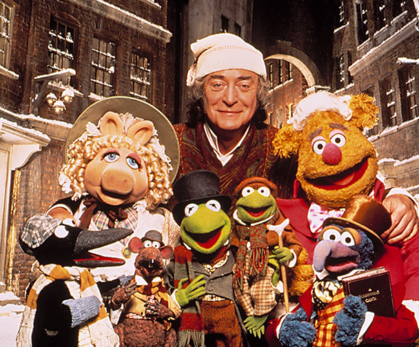 The muppets dressed in Christmas outfits