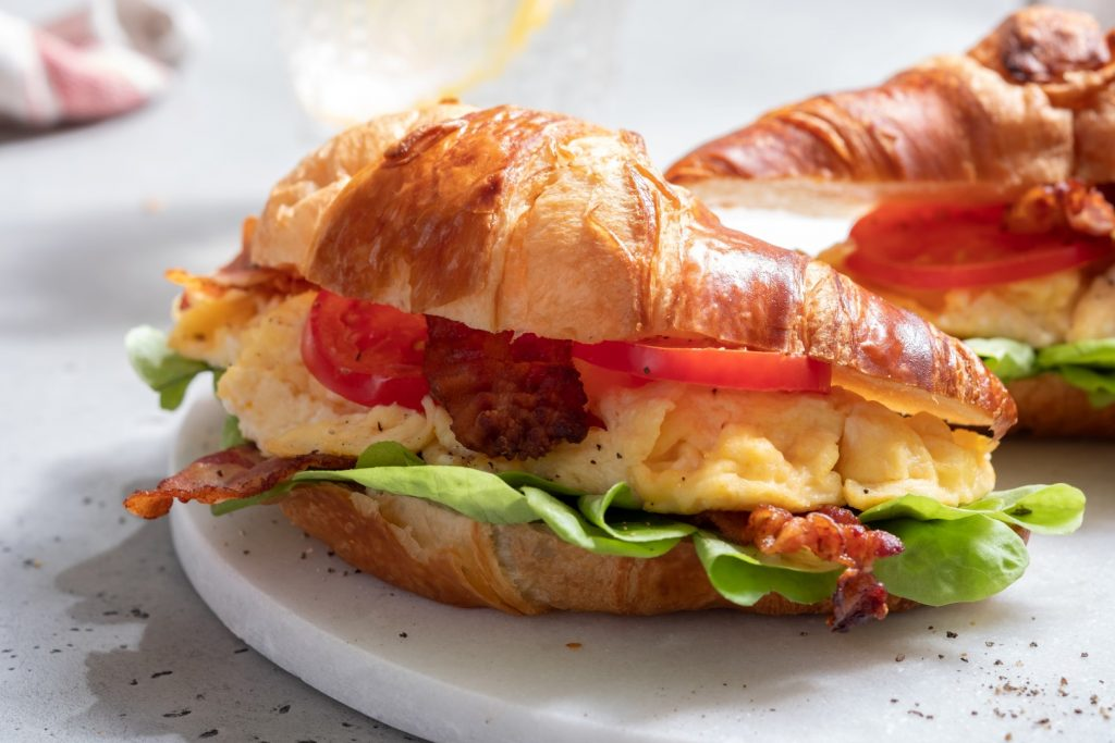 BLT bacon lettuce tomato sandwich croissant with scrambled egg