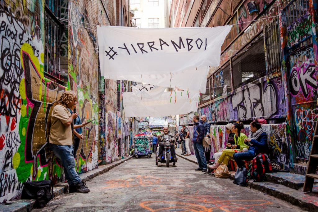 A group of people in a laneway