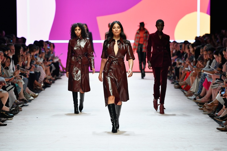 Models walking down the runway in leather outfits, wearing mid calf boots