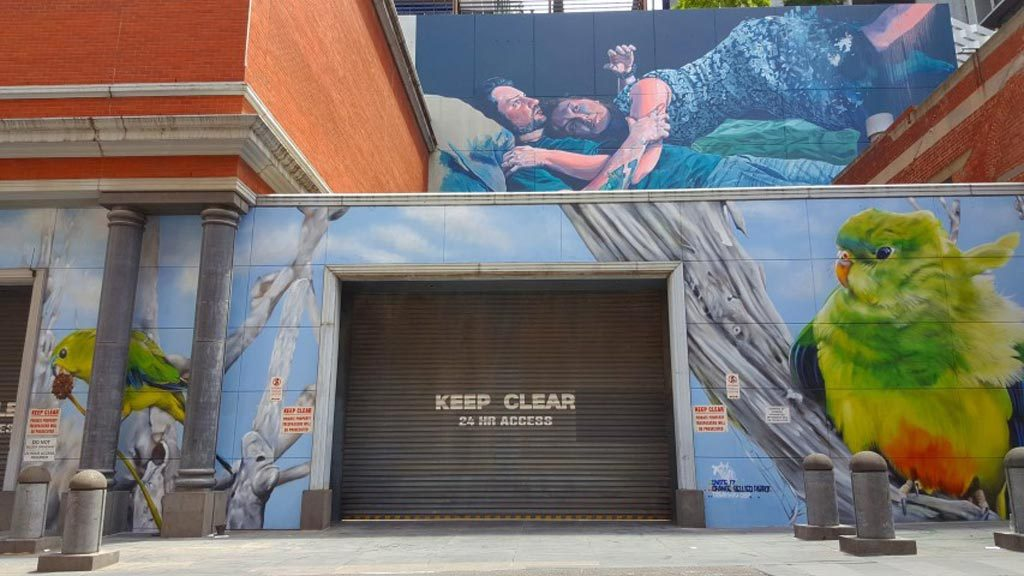 A garage door with a large bird mural on the right hand side