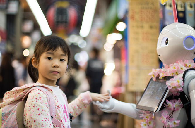 A little girl looking at a robot