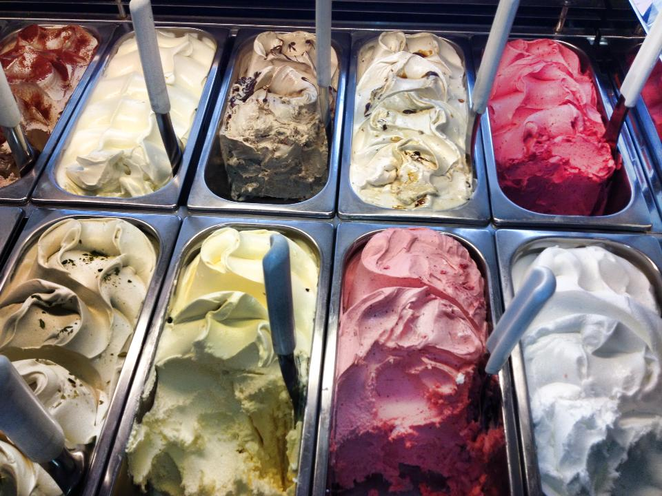 A range of gelato in tubs at an ice cream shop