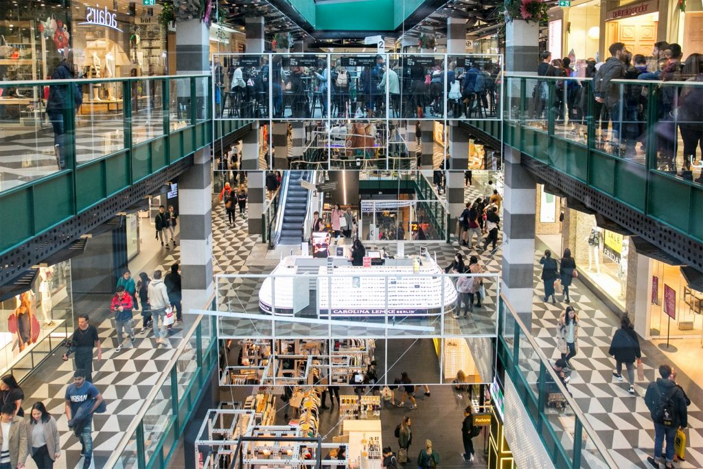 A busy shopping centre shot from the top floor looking down at the various levels