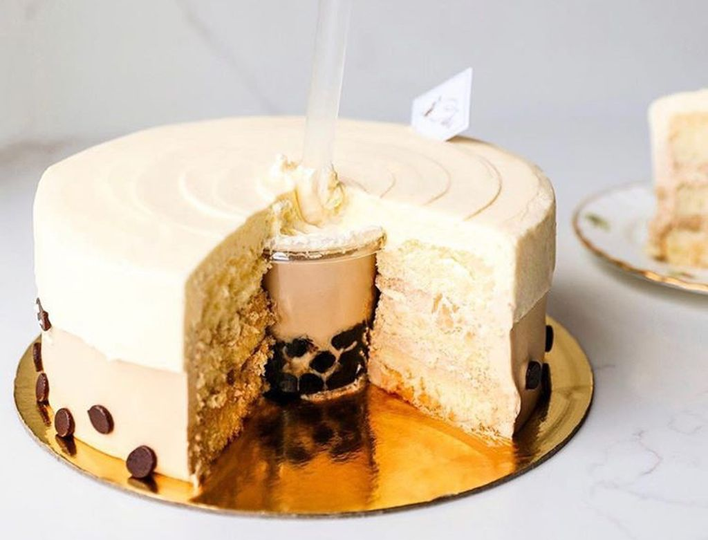 A cake with a cup of bubble tea inside it