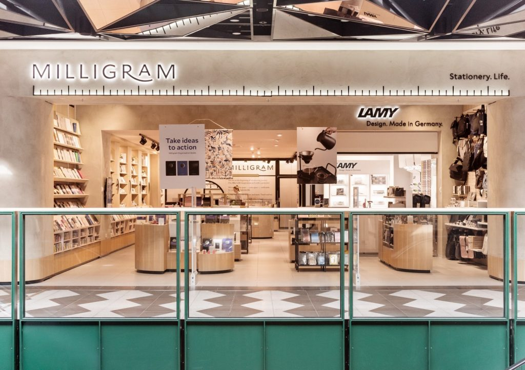 A large store in a shopping centre with beige detailing and shelves