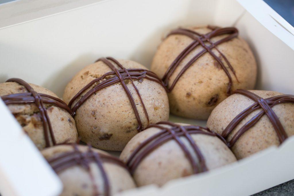 Six dumplings with milk chocolate crosses drawn on them
