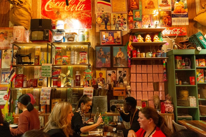 A brightly coloured kitschy restaurant with people dining at various tables