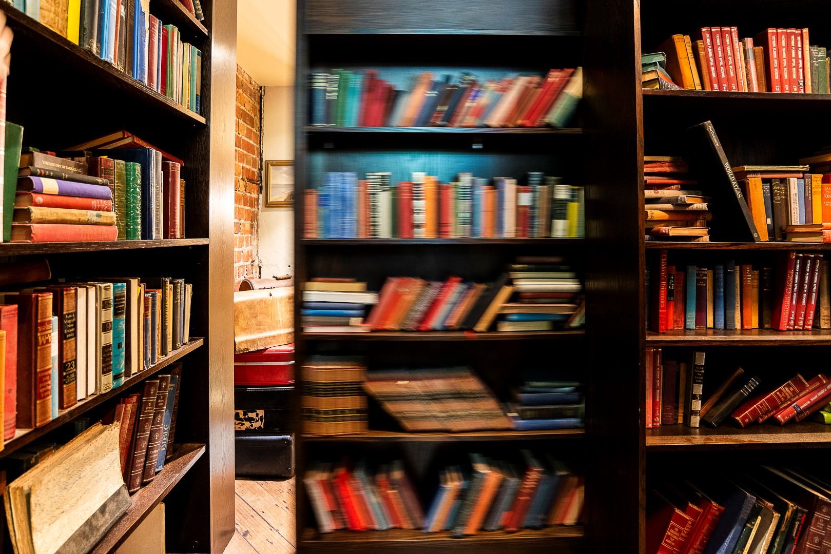 A bookshelf in the middle of a bar