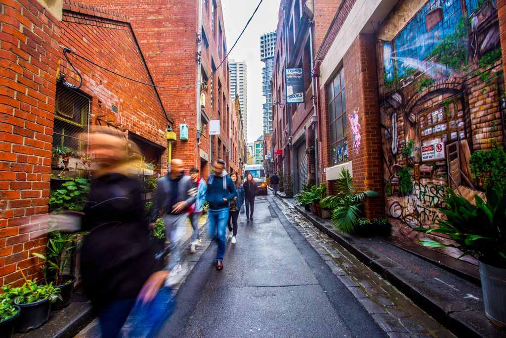 A narrow city laneway lined with brick buildings