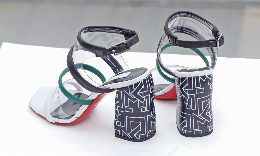 A pair of chunky heeled sandals with blue and white patterns on the heel