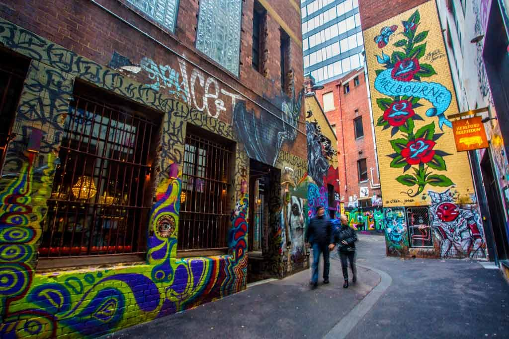 A tall mural in a laneway