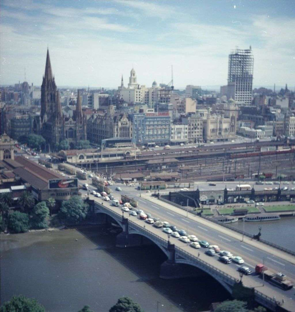 A colourised photo from the 1950s showing an aerial shot of a city
